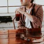 man drinking soda cola cafe